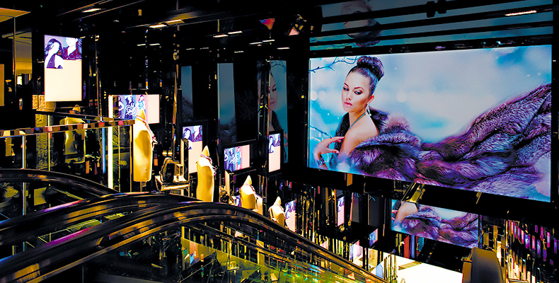 Luxury Retailer DFS Depends on Extron TouchLink Configurable Control and Twisted Pair Technology
