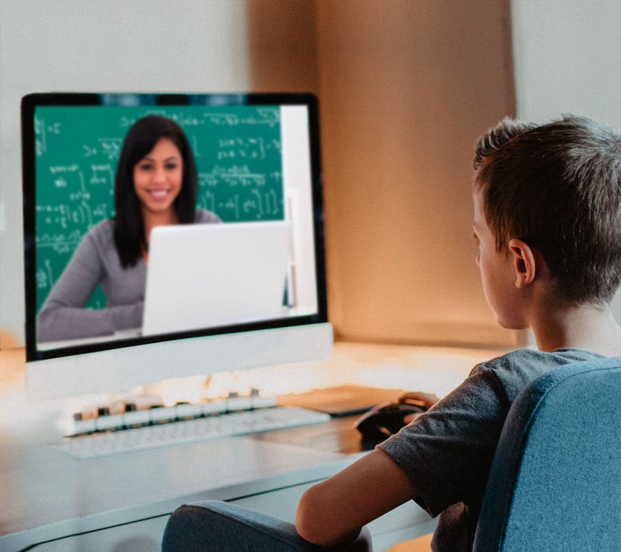 Student watching an online class at home