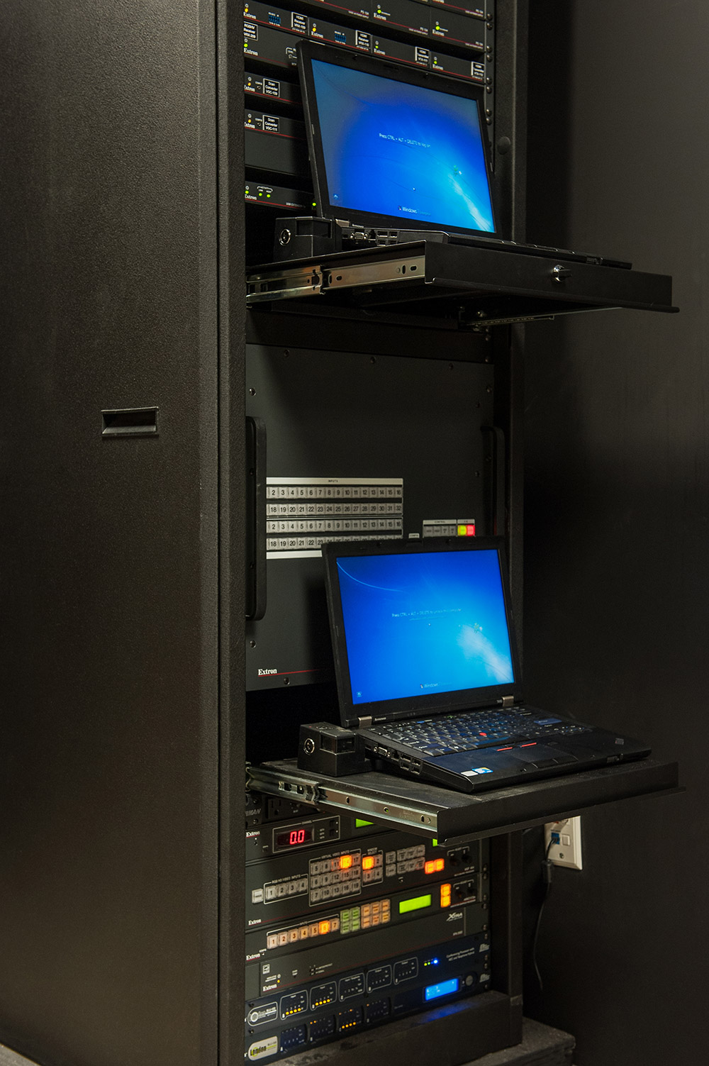 "AV equipment for the Executive Conference Room is rack-mounted in a room located behind the embedded 103"" plasma display."
