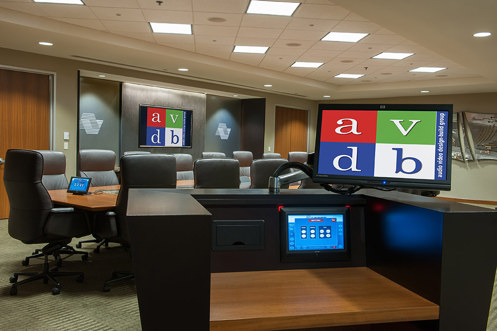 Multiple AV control options are located throughout the room, including from portable devices such as an iPad.