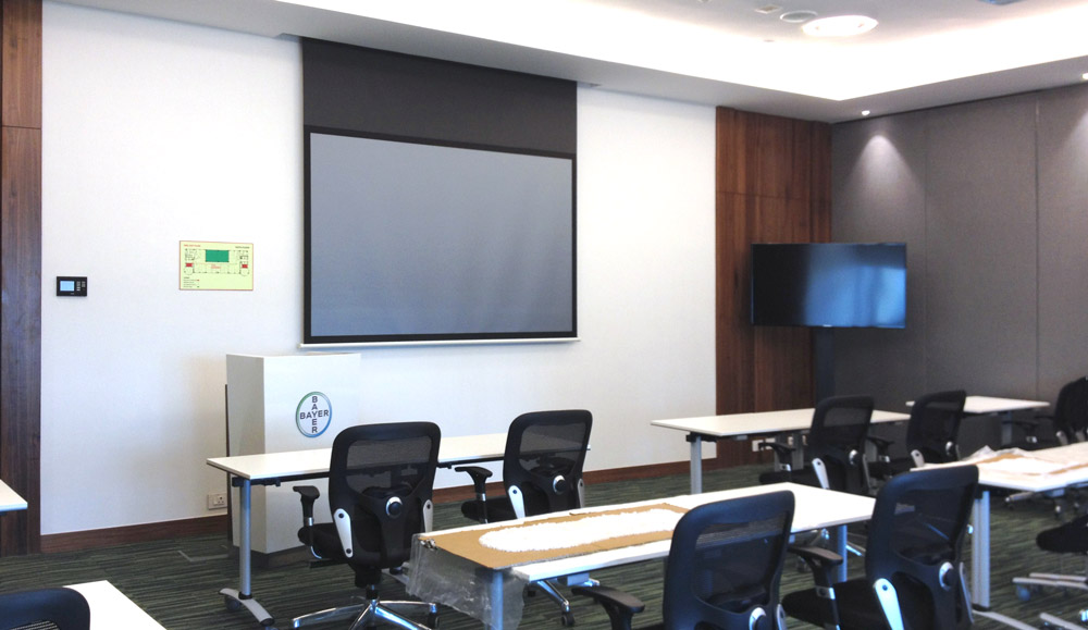 A single XTP CrossPoint 1600 provides AV and control signal switching and distribution within the four-way divisible boardroom and training space.