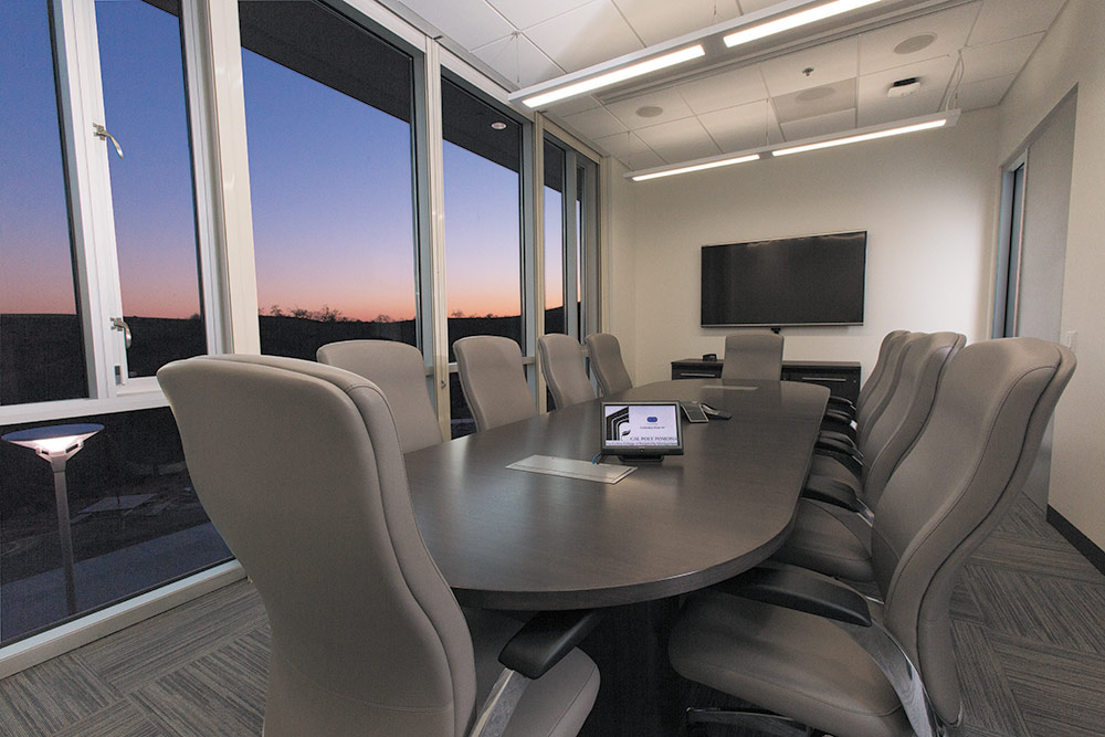 "An Extron 10"" TouchLink Pro touchpanel provide high performance AV signal routing and system control within each conference and Instructional Support room."