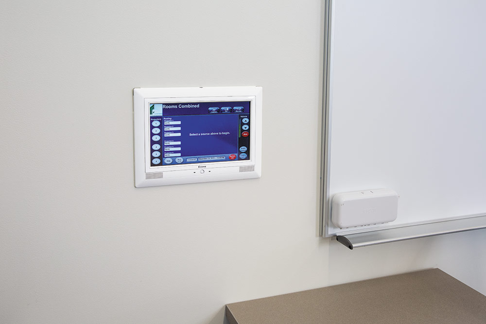 "TLP Pro 1020M 10"" TouchLink Pro touchpanels are mounted on the front and back walls of each lecture hall, allowing the instructor to move about the room."