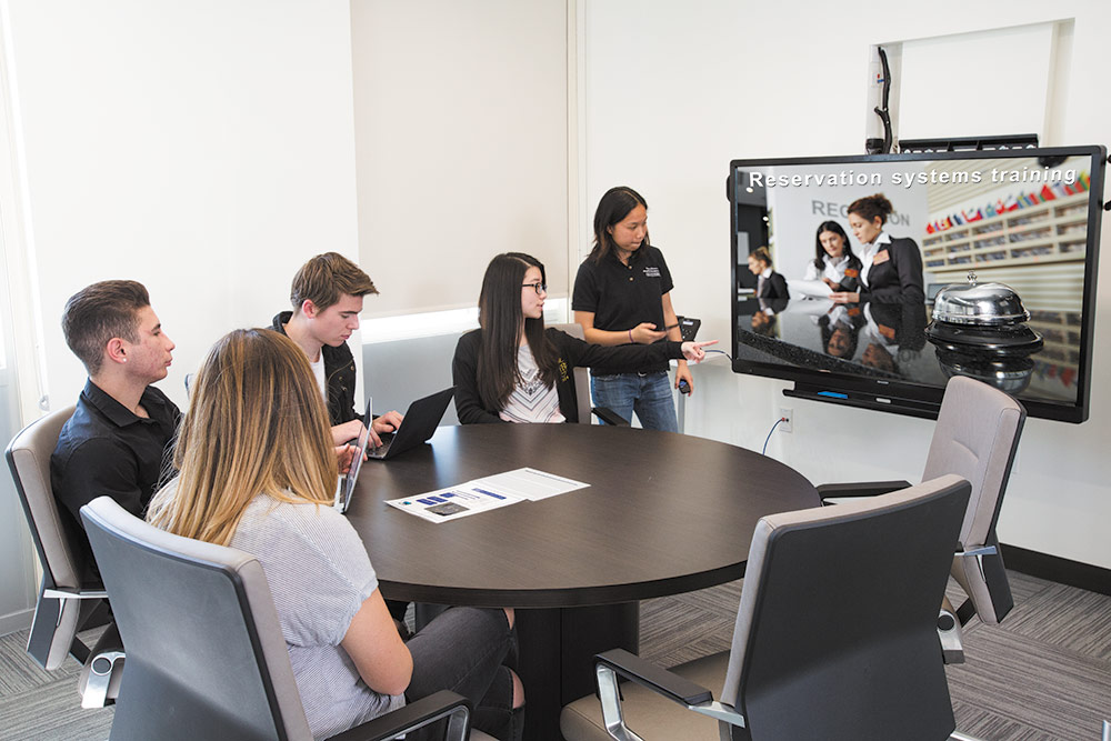 Group Study room with students looking at a flat panel display