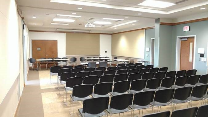 While this presentation room occupies only a quarter of the divisible conference area, it provides the same AV and control functionality as when the space is configured for town hall meetings.