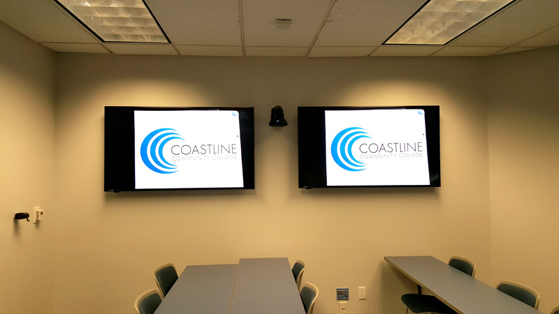 Flat panel displays on tilt mounts augment visibility for the students.