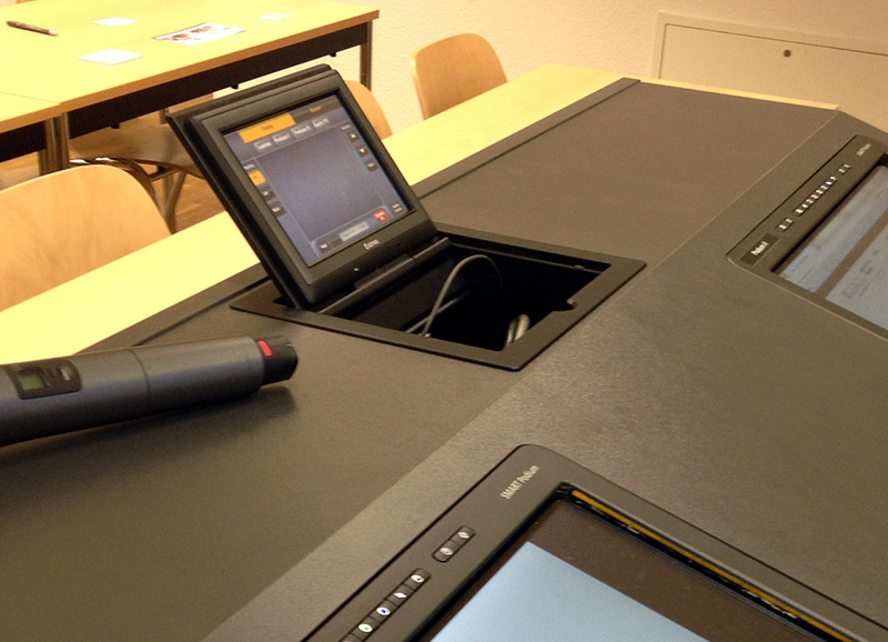The TLP 710CV TouchLink Touchpanel flips up to provide complete access to