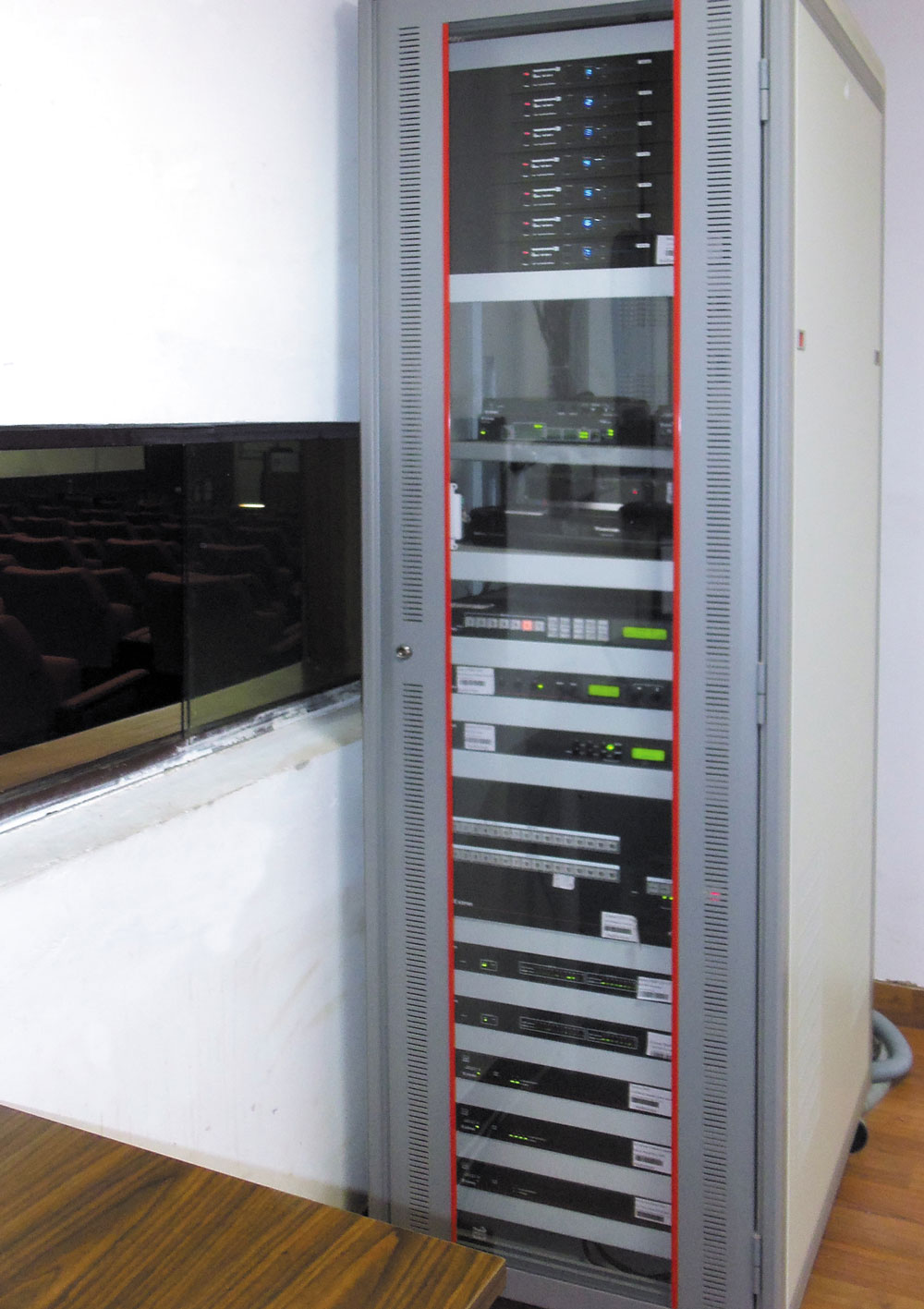 A single equipment rack in the control room houses most of the AV equipment for the auditorium, conference room, and training room.
