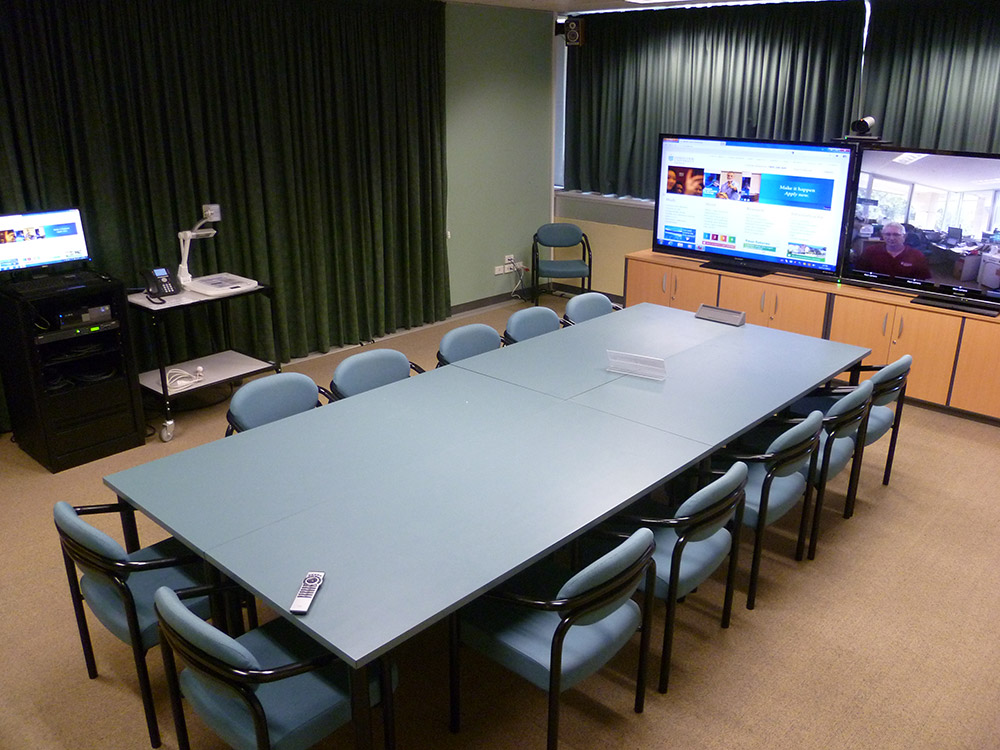 Each videoconference room includes a DVS 605 A for scaling and switching.