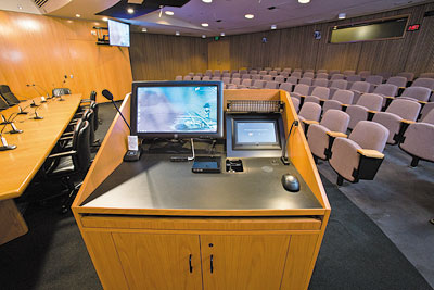 "To control presentation from within the boardroom, an Extron TLP 1000MV 10"", Wall Mount TouchLink® Touchpanel is embedded in the lectern next the ELO touch screen monitor."