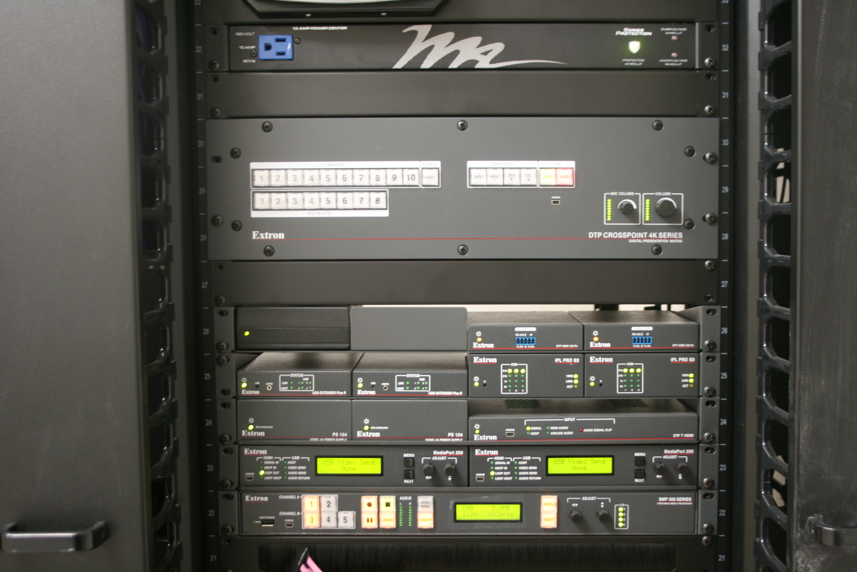 An Extron DTP CrossPoint 4K matrix switcher installed in the lectern provides AV switching, signal extension, audio amplification, and system control processing.