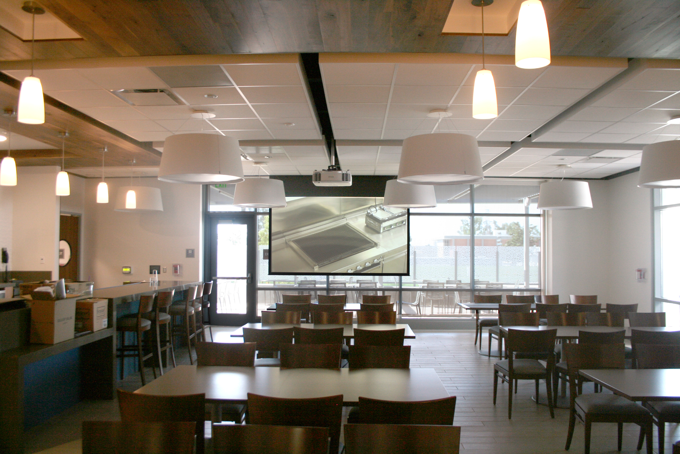 Culinary classroom with projector displaying live feeds from the PTZ camera system