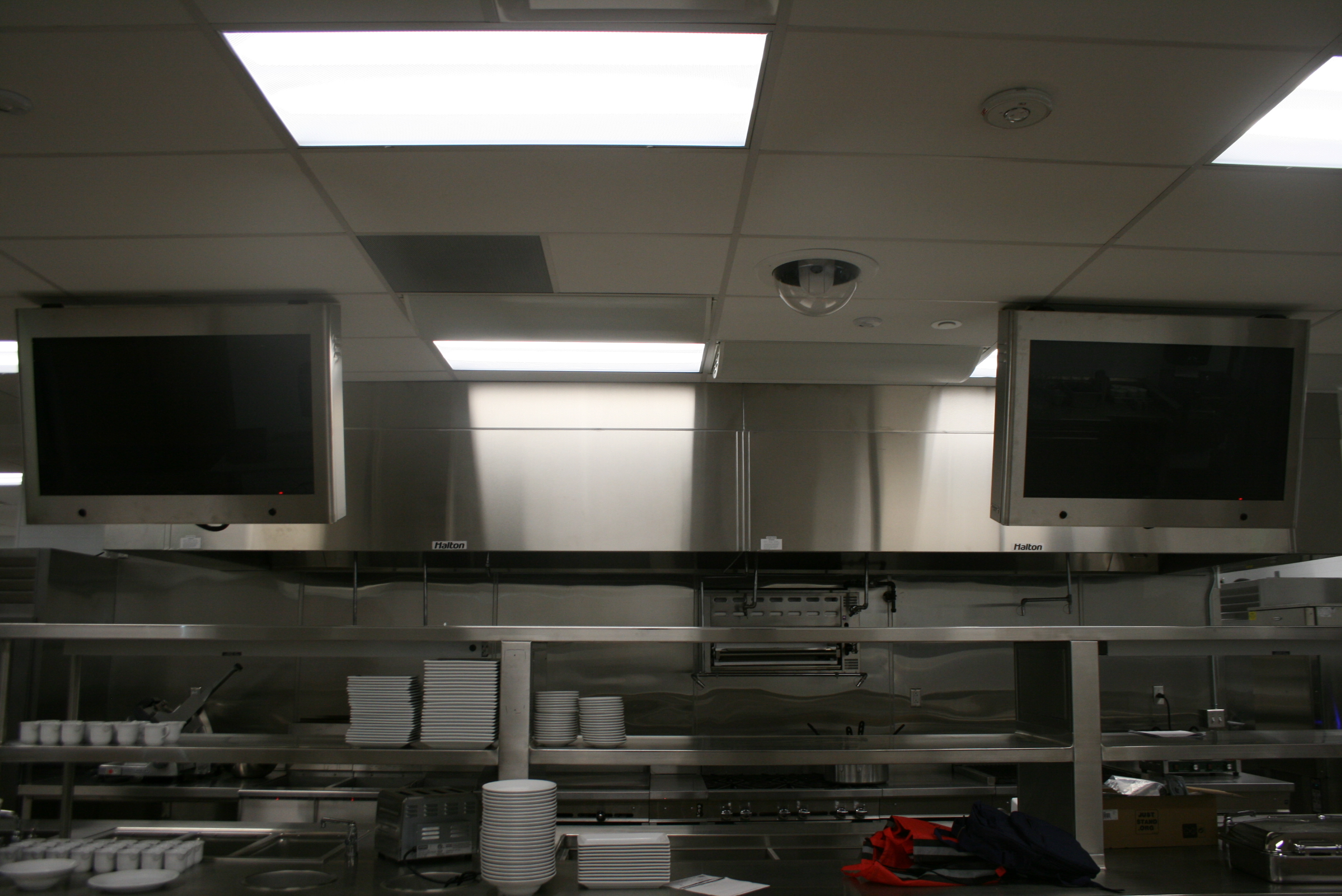 Flat panel displays mounted above each serving station