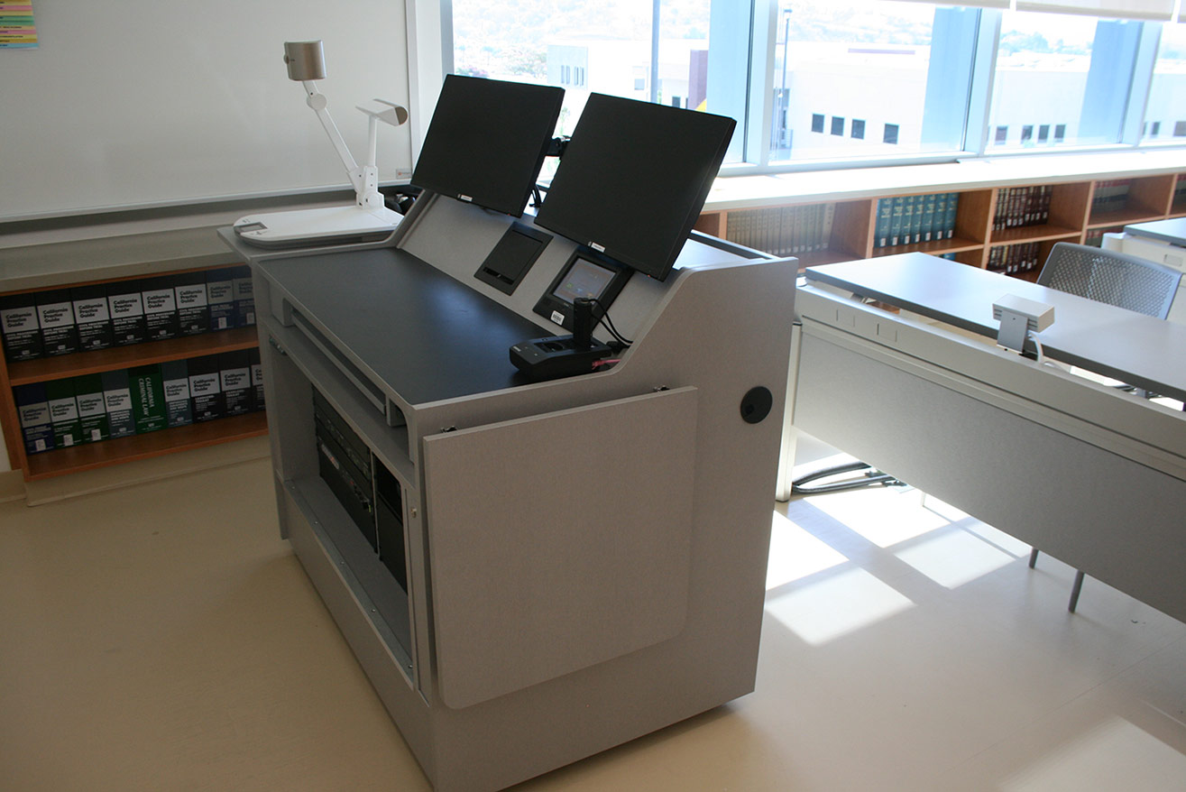 The college required AV systems components that were compact enough to fit within the custom teaching station, which was designed to have the smallest feasible footprint.
