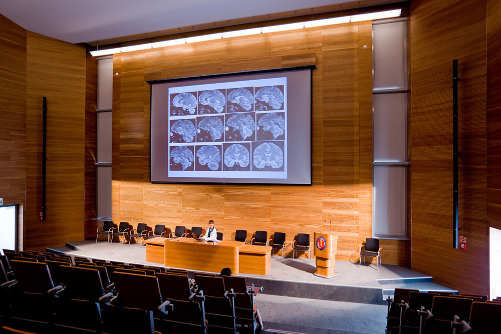 Content can be shared throughout the facility, including in the auditorium for larger audiences.
