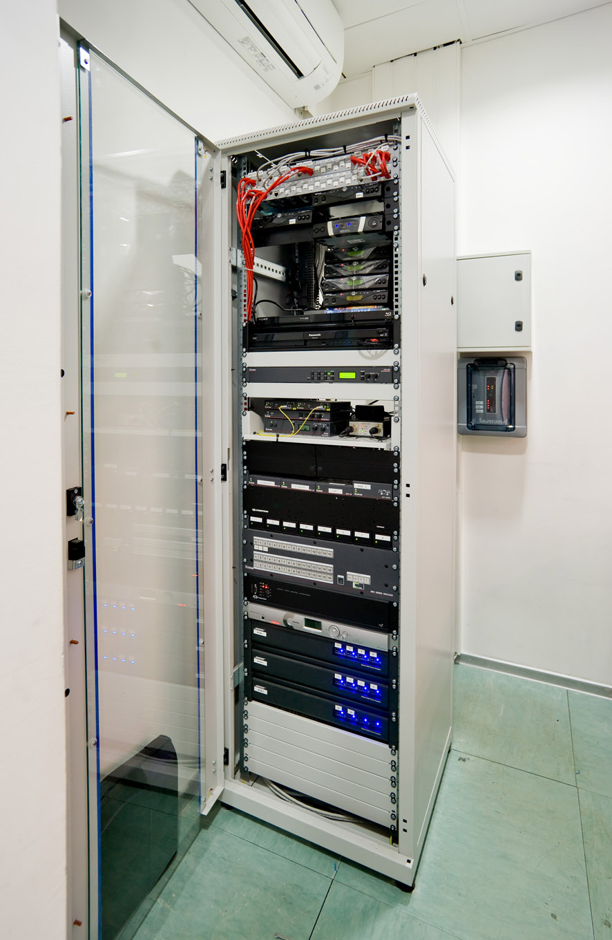 AV equipment for the auditorium is rack-mounted in the control room.