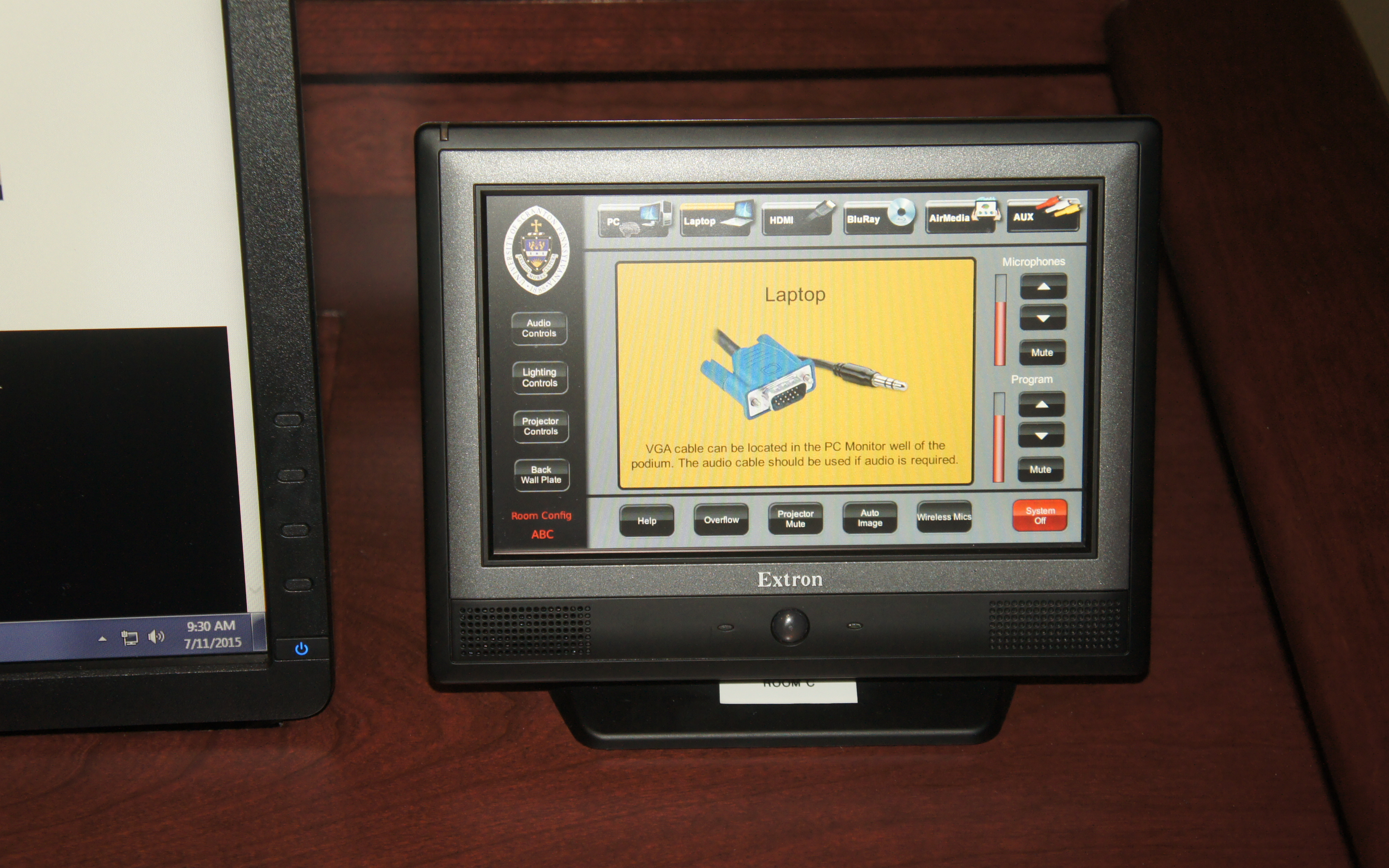 A TLP Pro 720T touchpanel provides intuitive control of AV system operation.