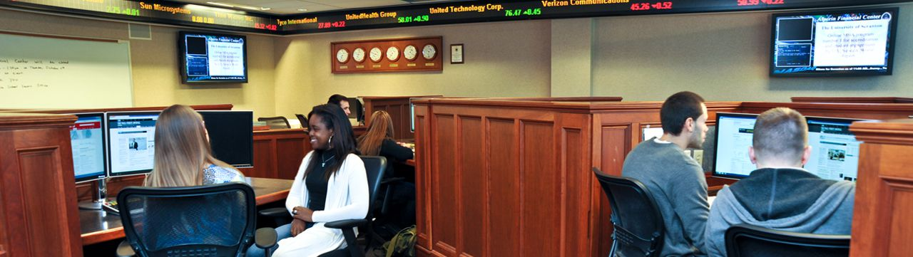 Student sitting in the Alperin Trading Room