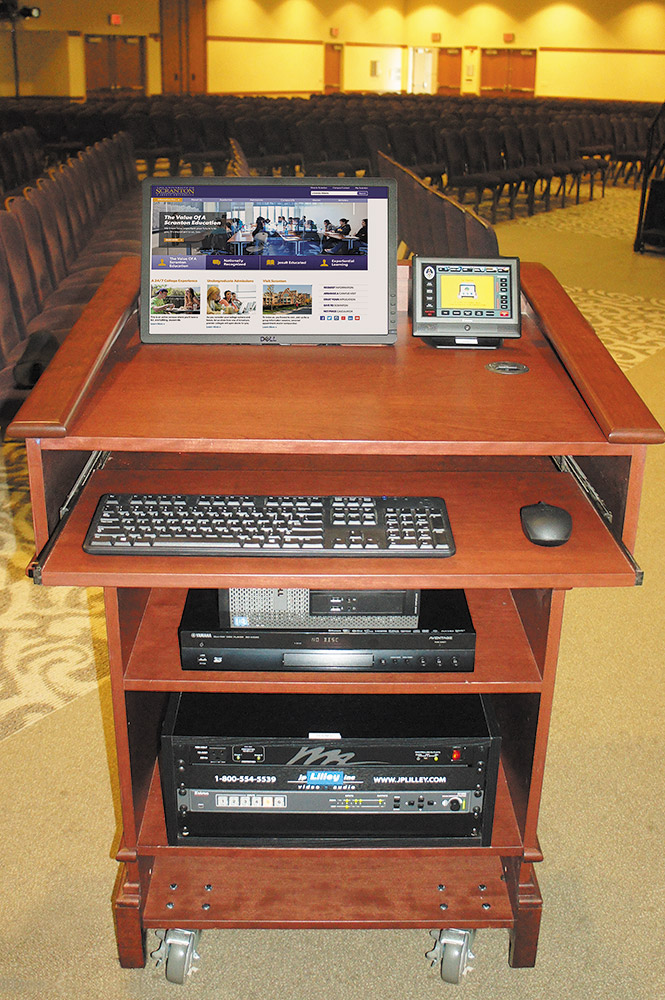 The TouchLink Pro touchpanels mounted on lectern