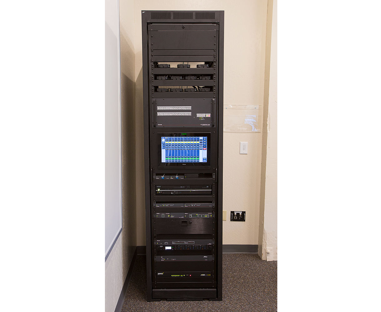 The Zoom computer and the MediaPort 200 are rack-mounted in the corner of the room.