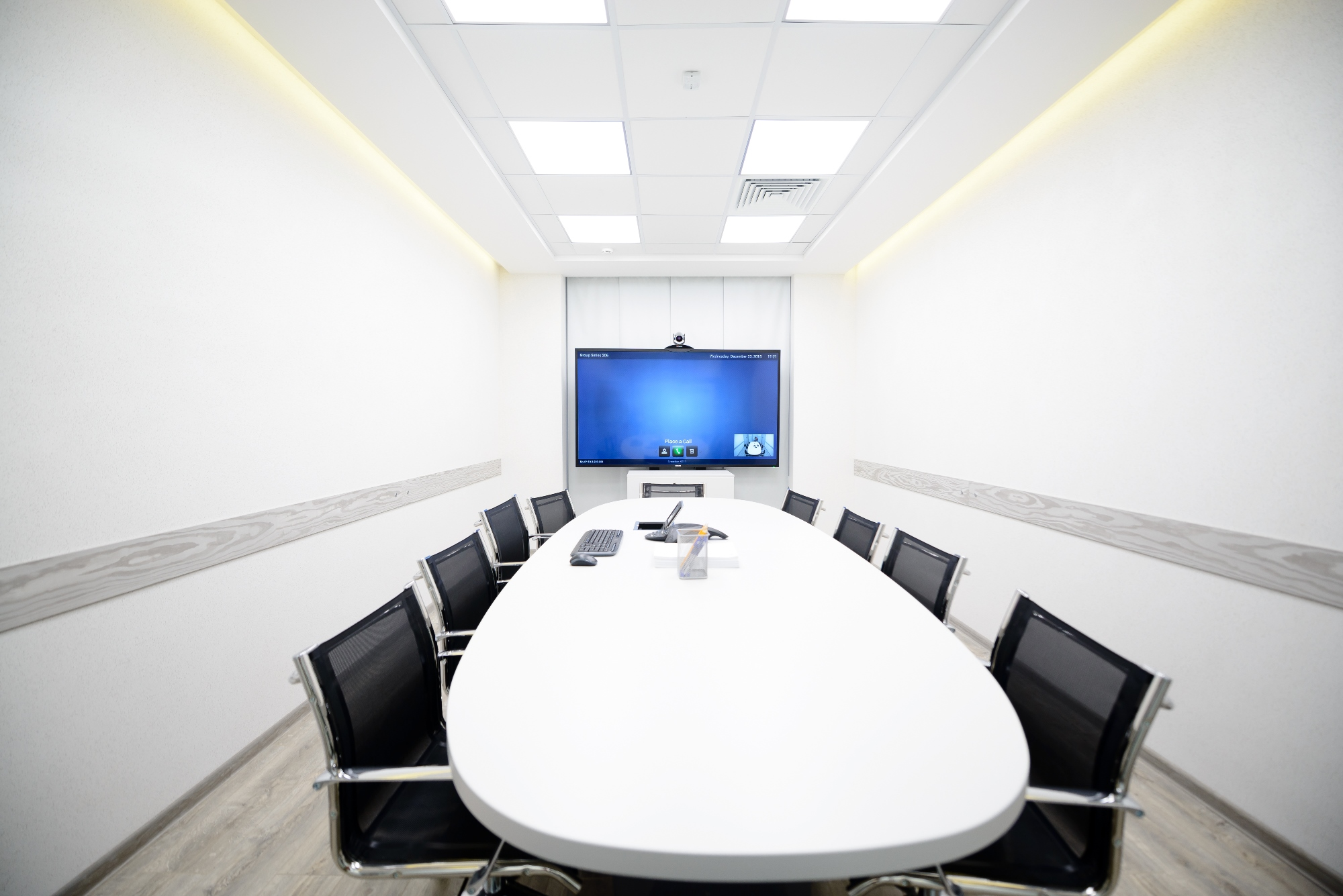 Rooms include an Extron Cable Cubby enclosure paired with a Retractor Series/2 cable access system to provide AV and LAN connectivity, as well as AC power, at the table.