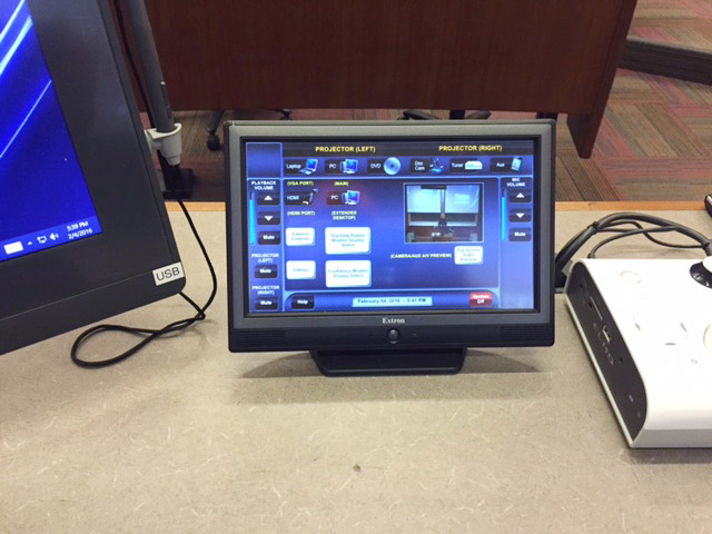 "An Extron TLP 1000TV 10"" Tabletop TouchLink Touchpanel at the Teacher Station provides user-friendly AV system operation."