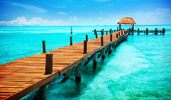 A pier in clear turquoise ocean