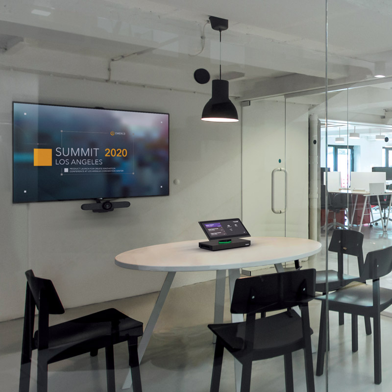 Huddle room with video conferencing equipment