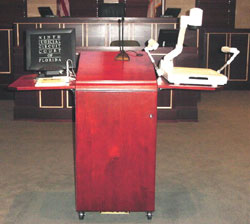 The evidence presentation system is located on a podium.